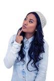 Donna asiatica con il dito sul mento Fotografia Stock
