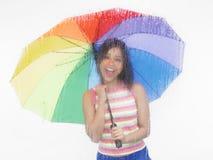 Donna asiatica con il suo ombrello fotografia stock libera da diritti