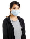 Donna asiatica con la maschera di protezione Fotografia Stock