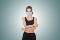 Donna asiatica con la mascherina fotografia stock