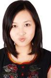 Donna asiatica con lo smorfia Immagine Stock