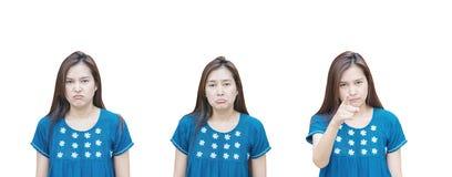 Donna asiatica del primo piano con un fronte di tre emozioni isolato su fondo bianco Fotografie Stock Libere da Diritti