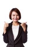 Donna asiatica di affari che mostra i pollici su Immagine Stock