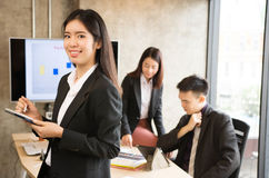 Donna asiatica di affari nella riunione Fotografia Stock