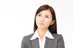 Donna asiatica difficile di affari fotografie stock