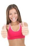 Donna asiatica emozionante di forma fisica che dà i pollici in su fotografia stock