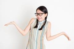 Donna asiatica incerta Immagine Stock