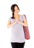 Donna asiatica incinta isolata sul predare bianco immagini stock libere da diritti