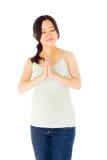 Donna asiatica incinta isolata sul predare bianco fotografie stock