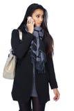 Donna asiatica sexy che fa una chiamata in studio Immagine Stock