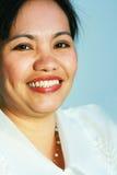 Donna asiatica sorridente Fotografie Stock