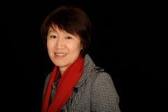 Donna asiatica sorridente Immagine Stock