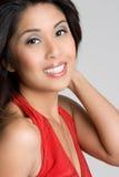 Donna asiatica sorridente Fotografia Stock