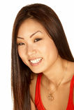 Donna asiatica sorridente che esamina la macchina fotografica Immagini Stock
