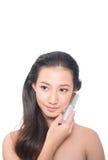 Donna asiatica su fondo bianco Immagini Stock