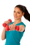 Donna attiva con l'allenamento delle teste di legno nella palestra di forma fisica isolata più Immagine Stock