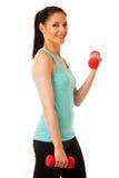 Donna attiva con l'allenamento delle teste di legno nella palestra di forma fisica isolata più Immagini Stock