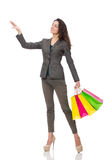 Donna attraente con i sacchetti della spesa isolati sopra Immagine Stock