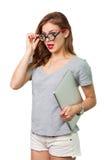 Donna attraente con i vetri di lettura fotografia stock