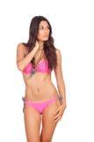 Donna attraente con il pensiero rosa dello swimwear Fotografia Stock