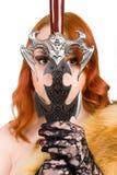 Donna attraente con una spada immagini stock