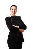Donna attraente felice con il dispositivo di piegatura Fotografia Stock