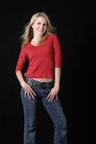 Donna attraente nell'usura giornaliere Fotografia Stock