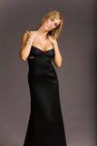 Donna attraente in vestito fotografie stock