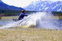 donna ATV di corsa immagine stock