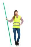 Donna in bastone riflettente di chiave di intensità della tenuta della maglia fotografie stock