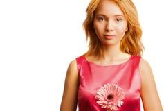 Donna bionda attraente che tiene un fiore Fotografie Stock