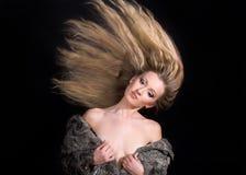 Donna bionda con capelli lunghi Fotografie Stock