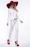 Donna bionda in costume bianco Fotografia Stock Libera da Diritti