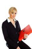 Donna bionda di affari con il raccoglitore dell'archivio fotografia stock