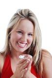 Donna bionda eccitata circa un grande diamante Fotografia Stock Libera da Diritti