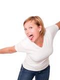 Donna bionda sorridente che mette fuori la sua linguetta sopra wh immagini stock libere da diritti