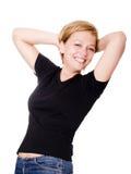 Donna bionda sorridente sopra priorità bassa bianca Immagini Stock