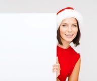 Donna in cappello dell'assistente di Santa con il bordo bianco in bianco Immagine Stock Libera da Diritti
