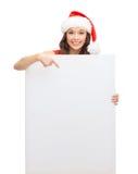 Donna in cappello dell'assistente di Santa con il bordo bianco in bianco Immagini Stock