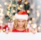 Donna in cappello dell'assistente di Santa con il bordo bianco in bianco Immagini Stock Libere da Diritti
