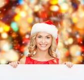 Donna in cappello dell'assistente di Santa con il bordo bianco in bianco Fotografia Stock