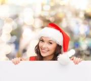 Donna in cappello dell'assistente di Santa con il bordo bianco in bianco Immagine Stock