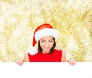 Donna in cappello dell'assistente di Santa con il bordo bianco in bianco Fotografia Stock Libera da Diritti