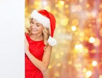 Donna in cappello dell'assistente di Santa con il bordo bianco in bianco Fotografie Stock