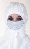 Donna in cappotto con la mascherina Fotografia Stock