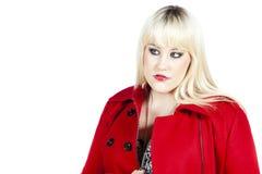 Donna in cappotto rosso Fotografia Stock