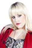 Donna in cappotto rosso Fotografie Stock