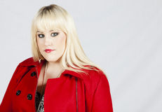 Donna in cappotto rosso Immagine Stock Libera da Diritti