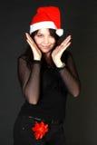Donna castana in cappello di Santa Immagini Stock