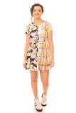 Donna castana in vestito Colourful Fotografia Stock Libera da Diritti